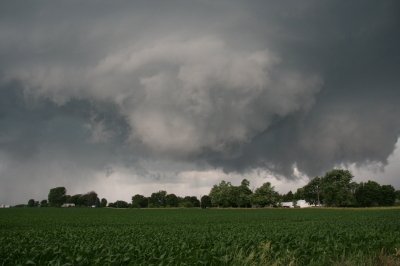The whitish wall cloud is half a mile from us and rotating vigorously.